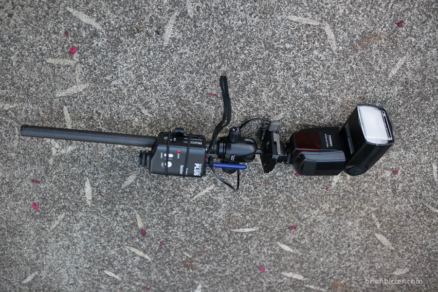 Yongnuo YN-560 mounted to a rusted carbon fiber pole with Manfrotto head